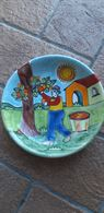Piatti in ceramica decorati a mano Nino Parrucca