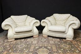 Coppia poltrone Chesterfield club in pelle bianco panna