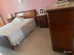 Camera da letto stile classico