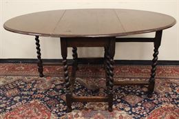 Tavolo circolare apribile in legno della metà del '900
